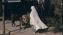 Shiraz, Iran 1973: mother walking in the street with her children Stock Footage