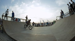 Slow Motion Of Bmx Rider during His Performing tricks in the ramp. Bmx-vert on - stock footage