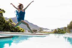 Elegant woman diving in the pool on a summers day Stock Photos