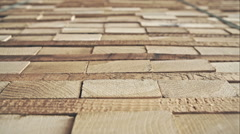 Stack of square wood planks for furniture materials - dolly motion. RAW video Stock Footage