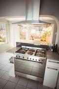 Cooker in stylish kitchen at home Stock Photos