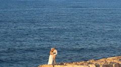 Wedding couple staying over beautiful landscape Stock Footage