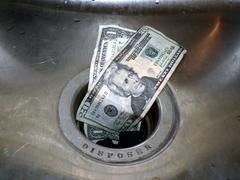 Money down the drain 2 Stock Photos