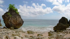 Small Waves on a Rocky Tropical Beach, with Sound. Video UltraHD Stock Footage