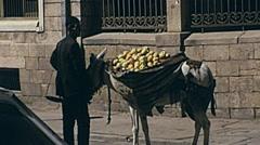 Shiraz, Iran 1973: man selling fruit in the street Stock Footage