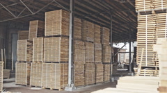 Stack of pile wood bar in lumber yard factory use for construction wood industr Stock Footage