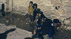 Iran 1973: women making laundry outdoor Stock Footage