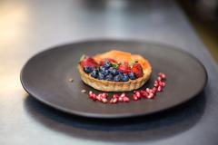 Fruit tartlet dessert in a commercial kitchen Stock Photos