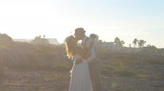 Bride and Groom kissing at sunset Stock Footage