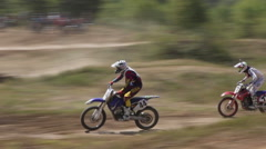 The competition in motocross on rough terrain. Stock Footage