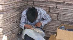 Argentine vendor making artworks from salt pieces - stock footage