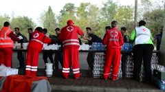 Volunteers from Red cross distributing help for refugees in Hungar - stock footage