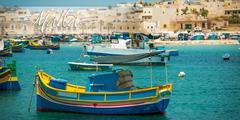postcard with fishing boats near village of Marsaxlokk - stock photo