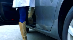 Slowmotion detail of woman´s legs which gets in car Stock Footage