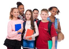 pupils with different complexion and clothes - stock photo
