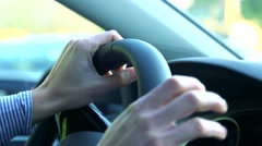 Slowmotion detail of woman´s hand takes a steering  wheel  Stock Footage