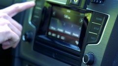 Slowmotion detail of woman´s hand who control a device on dashboard Stock Footage