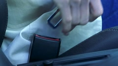 Slowmotion detail of woman who fasten the safety belt Stock Footage