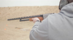 Man Rapidly Pumps and Fires Shotgun Stock Footage