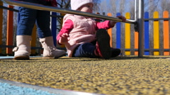 Children spinning playing on an outdoors playground in Sofia Bulgaria park Stock Footage