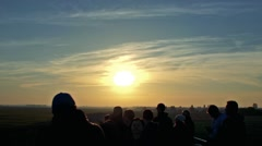 People stand and observe landscape at sunset Stock Footage