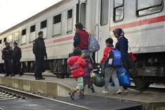refugees in Tovarnik (Serbian - Croatina border) - stock photo