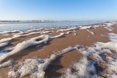 North sea sand beach and blue sky - stock photo