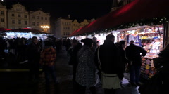 Visiting the street stalls at the Christmas Market in Prague Stock Footage