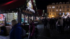 Walking by a food stall at the Christmas Market in Prague Stock Footage