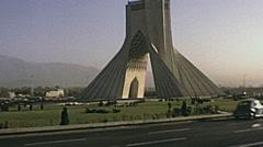 Iran 1973: traffic under Azadi tower Stock Footage