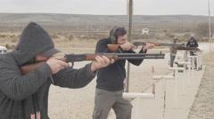 Men Shooting Rifles at the Gun Range - stock footage