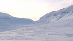 People ride sleds with siberian husky dogs on the snow in Longyearbyen, Norway. Stock Footage