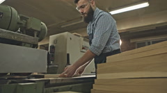 Carpenter working with Industrial tool in wood factory. RAW video record Stock Footage