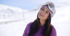 Gorgeous young woman posing in winter snow - stock footage