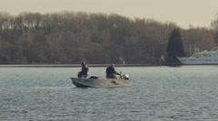 Two men fishing in little boat Stock Footage