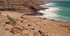 Waves crashing onto red cliffs, Kalabarri National Park, Western Australia Stock Footage