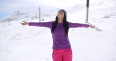 Happy young woman embracing the winter sun Stock Footage