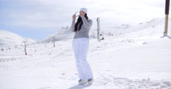 Attractive young woman standing in winter snow Stock Footage