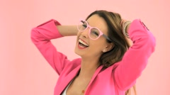 Cheerful model wearing eyeglasses, studio shot Stock Footage