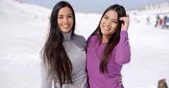 Laughing vivacious young women at a ski resort Stock Footage