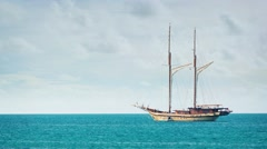 Extreme Zoom of a Wooden Sailboat, Anchored on the Tropical Horizon - stock footage