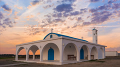Small christian church on a sunset background Stock Footage