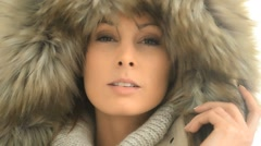 Closeup of woman wearing coat with fur hood, isolated - stock footage