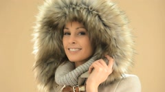 Closeup of woman wearing coat with fur hood, isolated Stock Footage