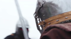 Reenactment of historical battle, two strong warriors sword fighting in the rain Stock Footage