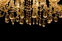 Gallant chandelier with black background and bottom copyspace Stock Photos