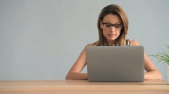Beautiful woman working on laptop, isolated Stock Footage