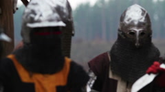 Medieval warriors preparing for battle, knights in armor, historical reenactment Stock Footage