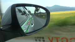 Mirror of a taxi driving through the South Korean countryside Stock Footage