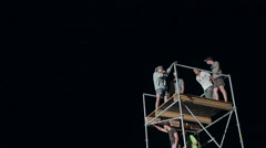 Close-Up of a Young Man Makes Extreme Jump From a Tower on an Air Cushion at - stock footage